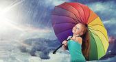 Redhead girl in the heavy rain — Stock Photo