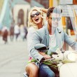 Charimgn lady riding a retro scooter with her boyfriend — Stock Photo #85014658