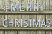 Letters christmas on wood  background — Stock Photo