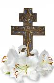 Christian cross and  lily on white background — Stok fotoğraf