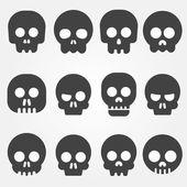 Cartoon skull with bones vector icon set — Stock Vector