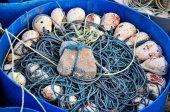 Fishing tool made by fisherman inside blue basket — ストック写真