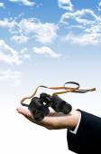 Smart vision concept, Binocular in hand — Stock Photo