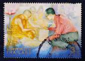 A stamp printed in Thailand shows an image of H.M. King Bhumibol offering, Celebrating the 6 th cycle birthday anniversary — Stock Photo