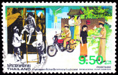 A stamp printed in Thailand shows image of postman working, To commemorate International Stamp Exhibition — Stock Photo