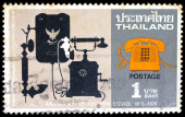A stamp printed in Thailand shows image of retro telephone, To commemorate 100th Anniversay of telephone service — Stock Photo