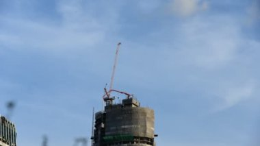 Time lapse of moving crane working on top of tower — Stock Video