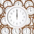 Background of wall clocks with brown wooden frame — Stock Photo #56235371