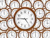 Set of wall clocks with brown wooden frame — Stock Photo