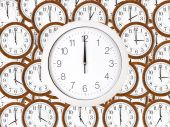 Background of wall clocks with brown wooden frame — Stock Photo