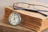 Pocket watch next to book — Stock Photo