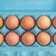 Brown hen eggs in a blue box — Stock Photo #56328363