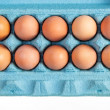 Brown hen eggs in a blue box — Stock Photo #56328389