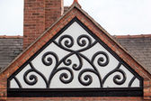 Medieval ornament in the timbered building roof — Stock Photo