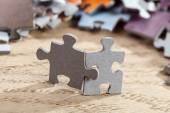 Two jigsaw puzzle pieces on table — Stock Photo