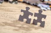 Two Jigsaw Puzzle Pieces on Table — Foto de Stock
