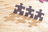 Three Jigsaw Puzzle Pieces on Table — Stock Photo