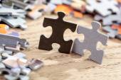 Black and Grey Jigsaw Puzzle Pieces on Table — Stock Photo
