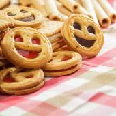 Pile of Cookies with Smiling Faces on Table — Stock Photo