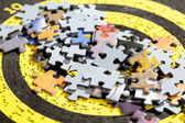 Jigsaw Puzzle Pieces on Old Yellow Target — Stock Photo