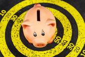Piggy Bank on Old Target Board — ストック写真