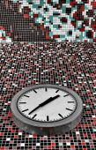 Classic clock on mosaic tiled wall — Stock Photo