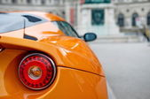 Back of an orange sports car — Stock Photo