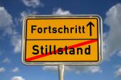 German road sign stagnancy and progress — Stock Photo