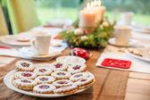 Coffee table with Christmas cookies — Stockfoto