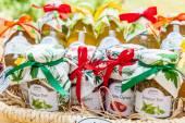 Basket with homemade chutneys and jams — Stock Photo