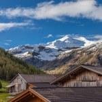 Постер, плакат: Alpine peaks and alpine huts