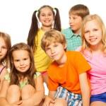 Six kids sitting together — Stock Photo #52640905