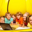 Six kids lay in yellow tent — Stock Photo #52640935