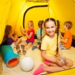 Kids play in camping tent — Stock Photo #52640975