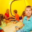 Boy with friends in camping tent — Stock Photo #52641055