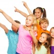 Six happy kids pointing fingers — Stock Photo #52641243