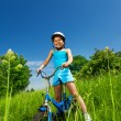 Little smiling girl on bicycle — Stock Photo #52642157