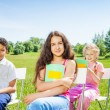 Three children hold notebooks — Stock Photo #52643231