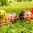 Two boys laying on grass together — Stock Photo #52643513
