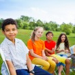 Five happy friends sit on chairs — Stock Photo #52643649