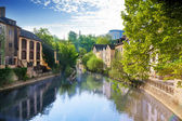 Houses reflecting in Alzette river — Stock Photo