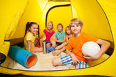 Boy with ball in camping tent — Stock Photo