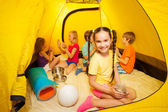 Kids play in camping tent — Stock Photo