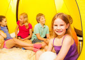 Nice little girl in camping tent — Stock Photo