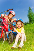 Two little girls fixing bicycles — ストック写真
