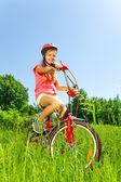 Nice teenage girl on bicycle — Stock Photo