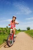 Teenage girl sitting on bike — Stock Photo