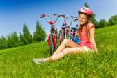 Young girl in red on meadow — Stock Photo