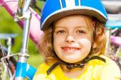 Young little girl and bikes — Stock Photo