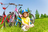 Little girl with bicycles — Stock Photo